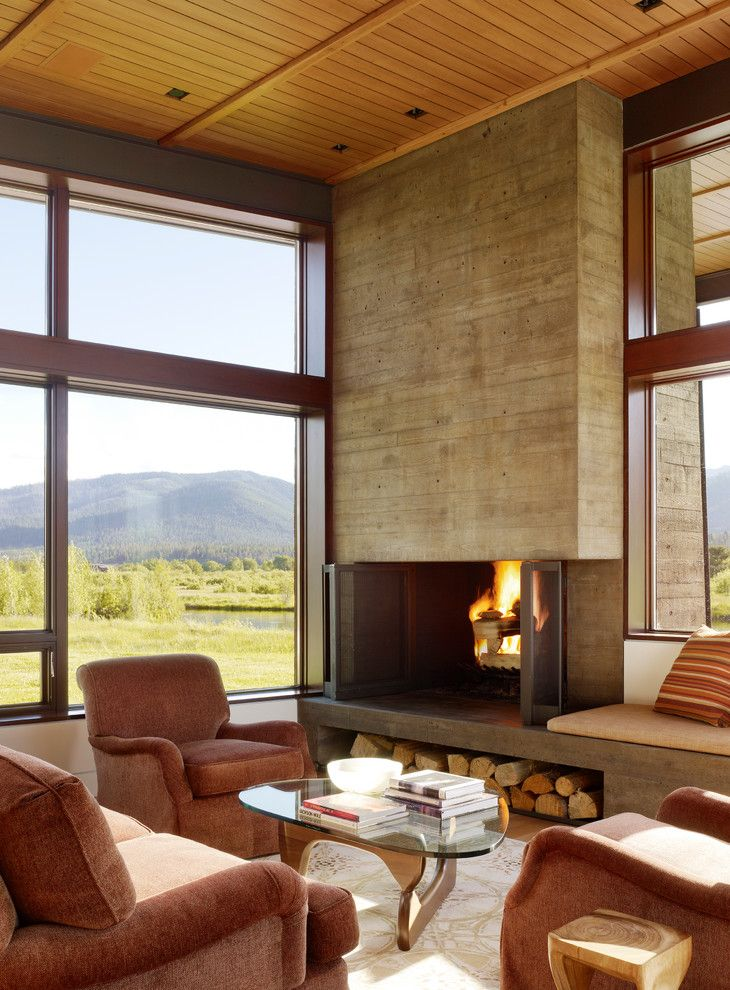 Loewen Windows for a Modern Living Room with a Brown Armchair and Indian Springs Ranch Residence by Carney Logan Burke Architects