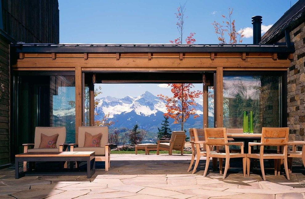 Loewen Windows for a Rustic Patio with a Two Sided Patio and Wilson Mountain Residence by Poss Architecture + Planning + Interior Design