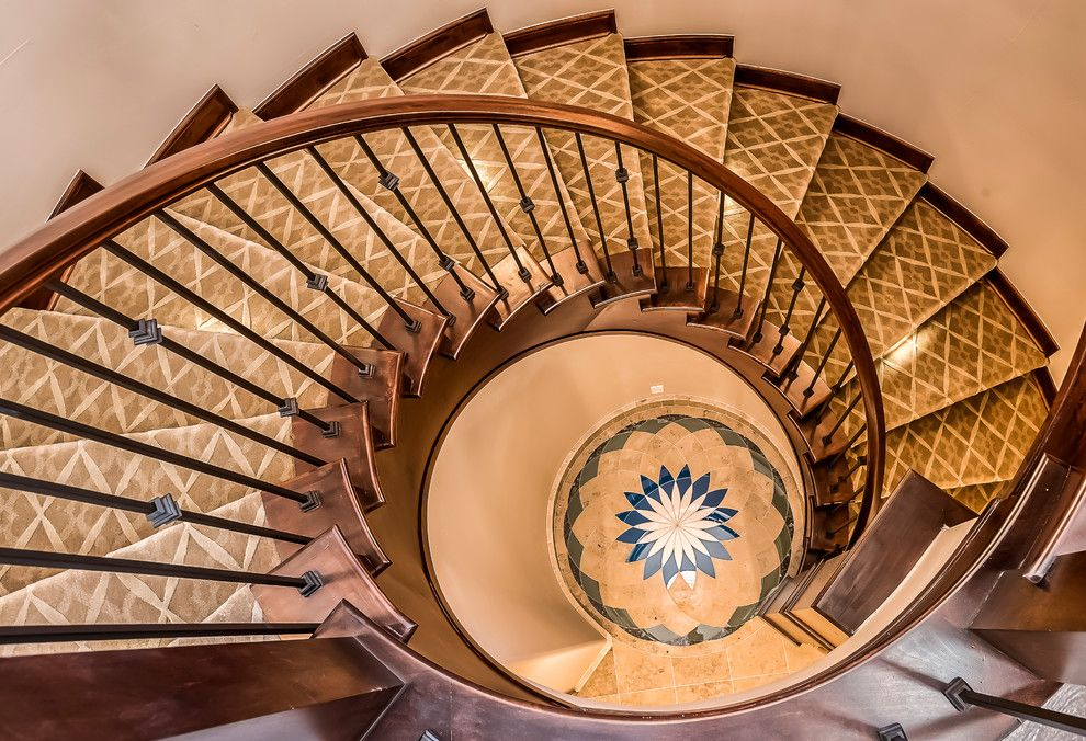 Low Pile Carpet for a Mediterranean Staircase with a Wrought Iron Spindles and Polo Club Custom Home by Augusten Muller Homes