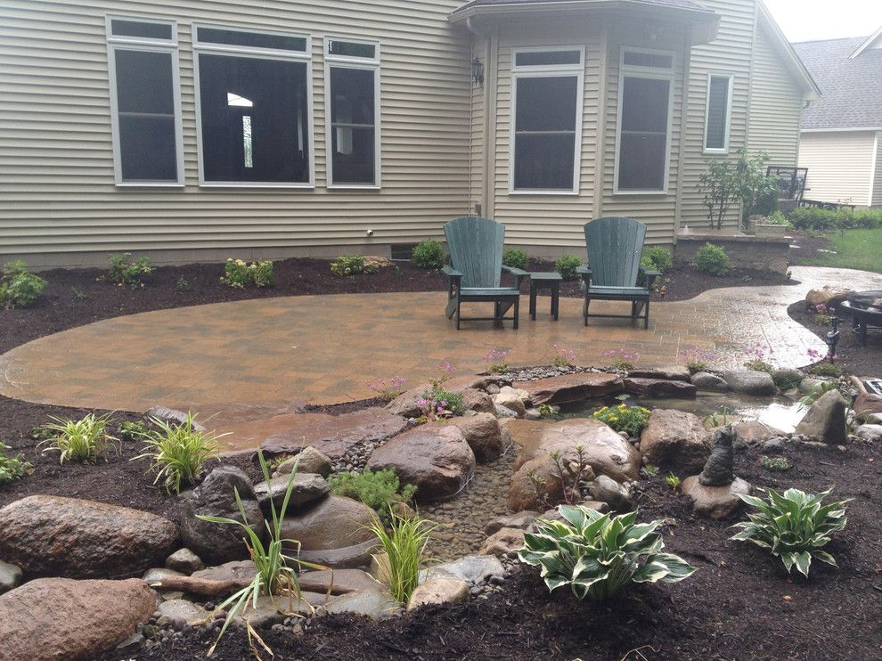 Lowes Albany Ny for a Traditional Patio with a Pond and Patios, Steps, Lighting, Ecosystem Koi Pond, Plantings in Rochester Ny by Acorn Ponds & Waterfalls