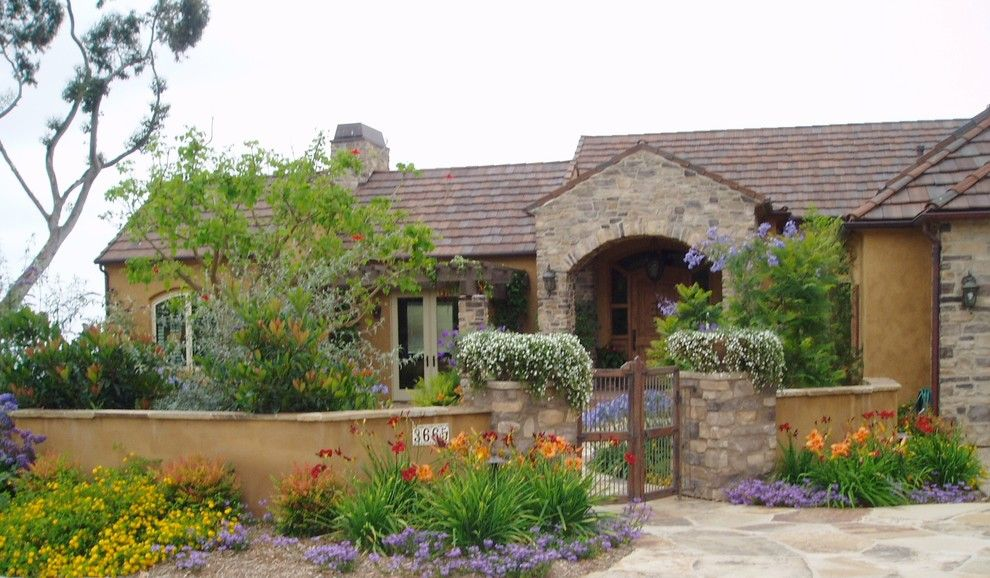 Lowes Carlsbad for a Mediterranean Landscape with a Pots and Design Build: Carlsbad Tuscan Colors by the Design Build Company