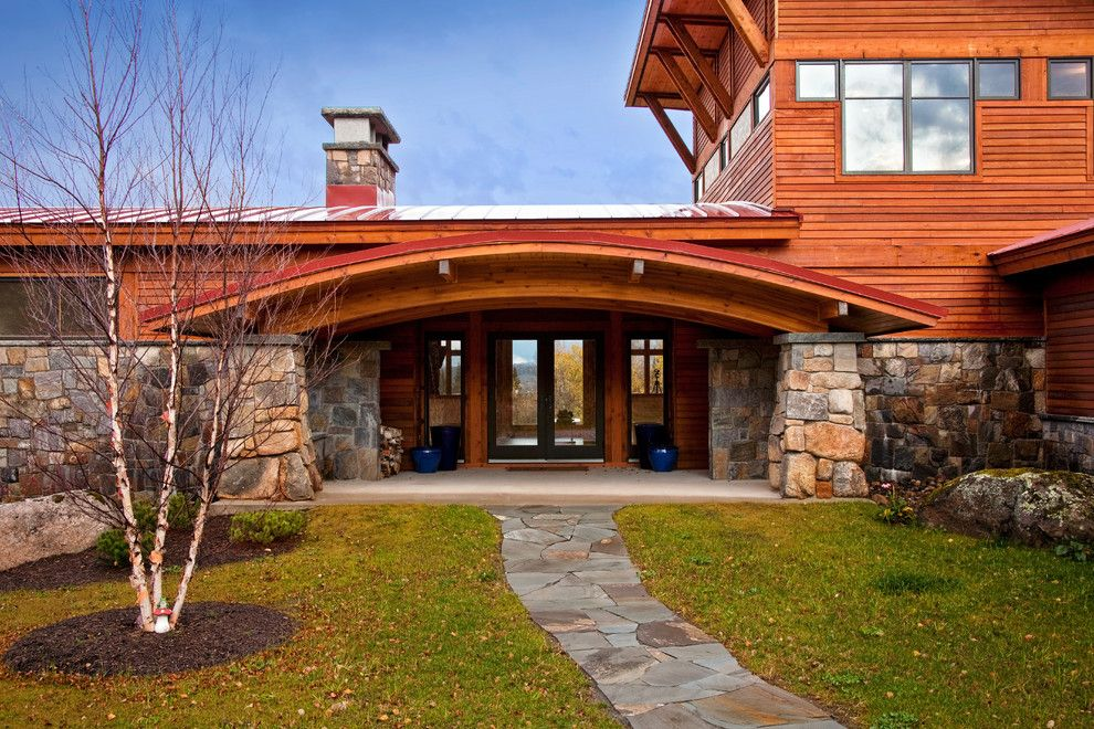 Lowes Easley Sc for a Eclectic Entry with a Stone Path and Saranac Lake House by Phinney Design Group