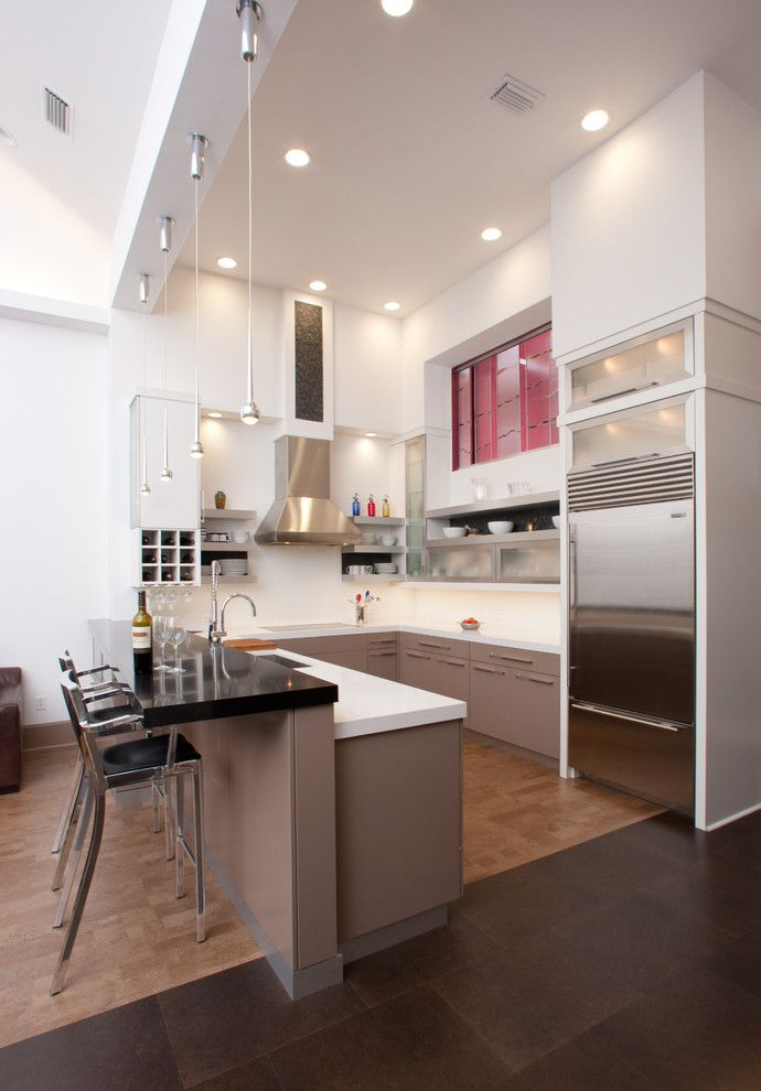 Lowes Gainesville for a Contemporary Kitchen with a Dark Floor and Gainesville by Busby Cabinets