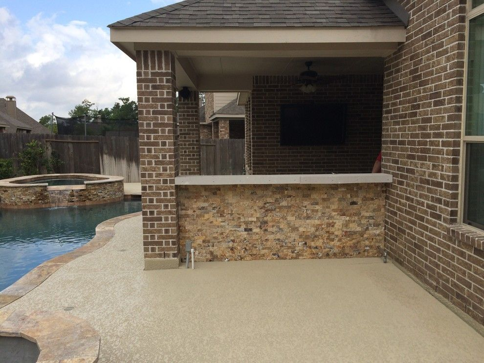 Lowes Memphis for a Rustic Patio with a Beautiful Pools and Houston Outdoor Kitchen with Traeger Grill and Scabos Split Face Stone by Outdoor Homescapes of Houston