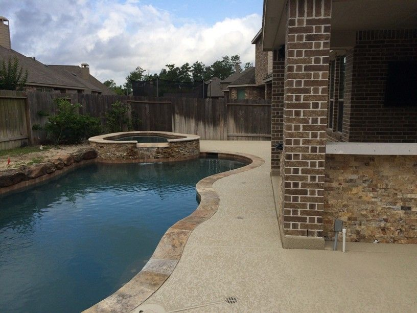Lowes Memphis for a Rustic Patio with a Indoor Outdoor and Houston Outdoor Kitchen with Traeger Grill and Scabos Split Face Stone by Outdoor Homescapes of Houston
