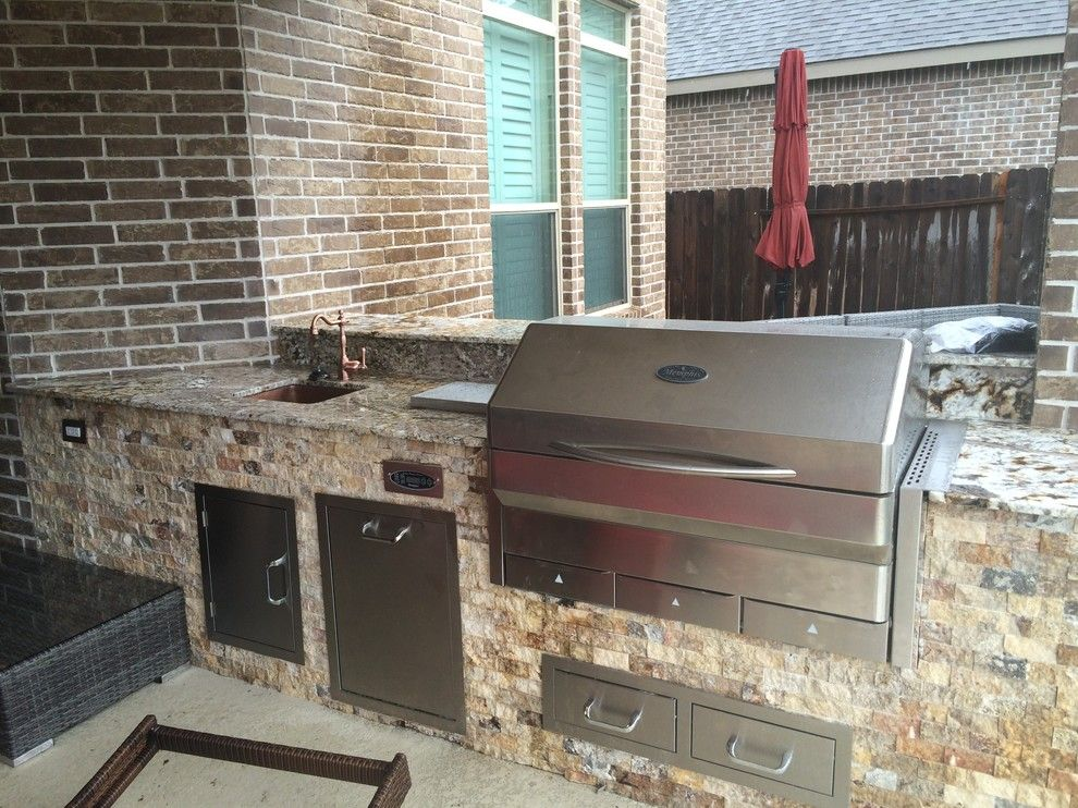 Lowes Memphis for a Rustic Patio with a Normandy and Houston Outdoor Kitchen with Traeger Grill and Scabos Split Face Stone by Outdoor Homescapes of Houston