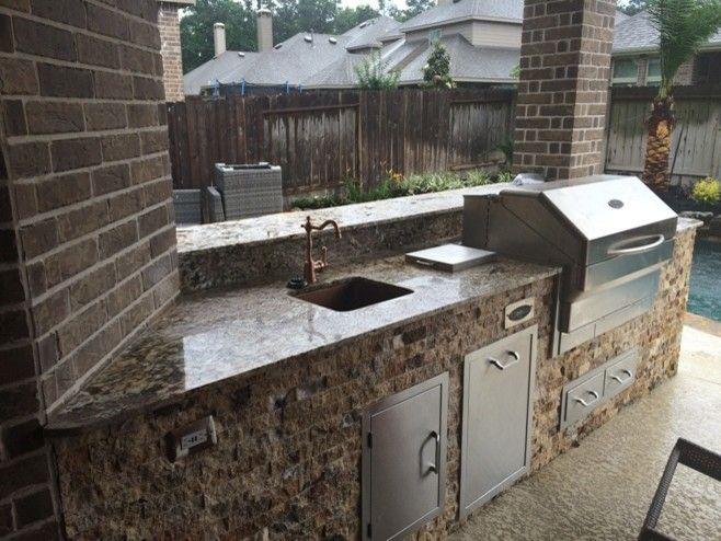 Lowes Memphis for a Rustic Patio with a Split Face Natural Stone and Houston Outdoor Kitchen with Traeger Grill and Scabos Split Face Stone by Outdoor Homescapes of Houston