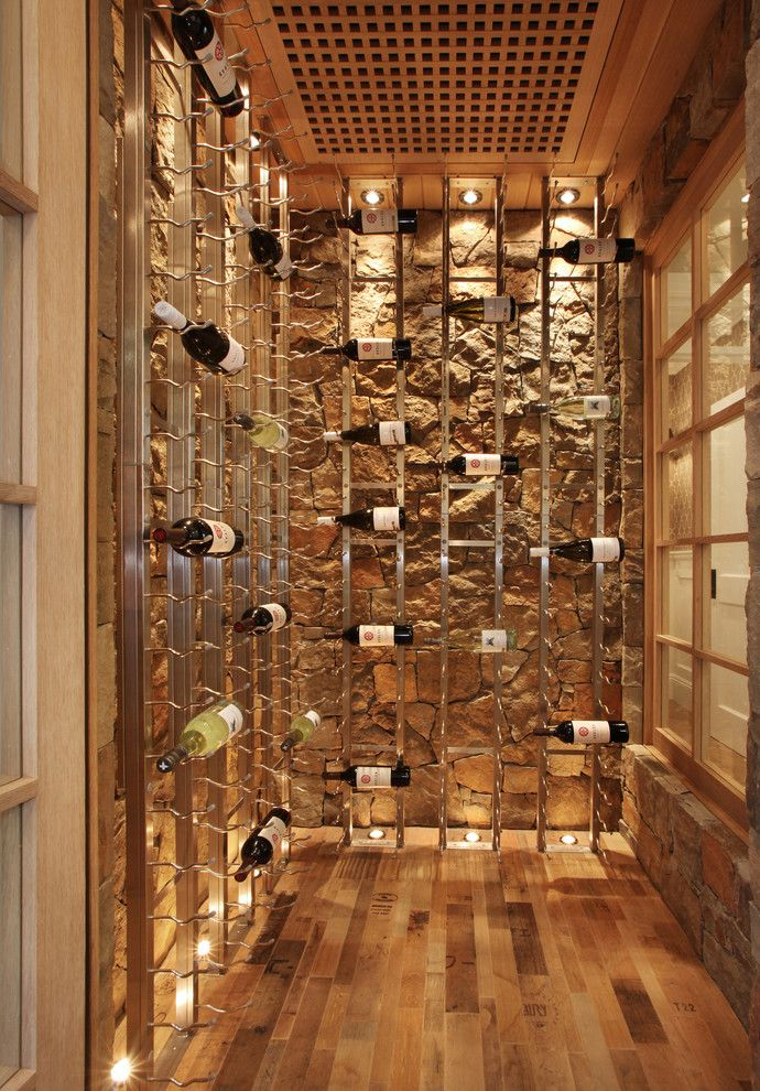 Lowes Metairie for a Beach Style Wine Cellar with a Built in Storage and Bayshores Drive by Brandon Architects, Inc.