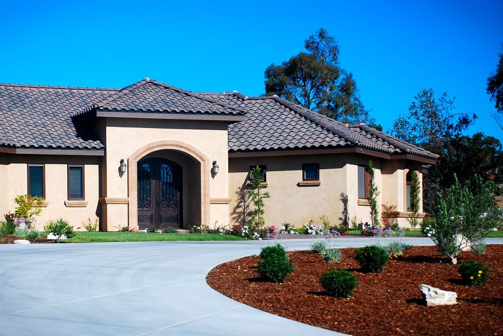 Lowes Paso Robles for a Mediterranean Exterior with a Cast Iron Door and Championship Way Mediterranean by Odenwald Construction Company
