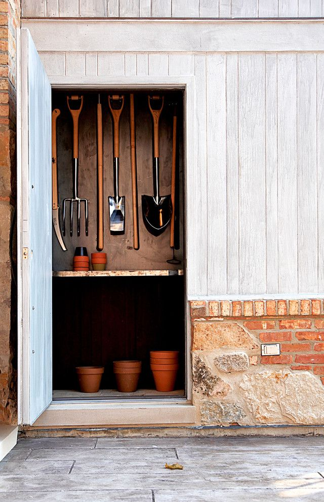 Lowes Tool Rental for a Rustic Shed with a Brick Exterior and Garden Shed by Mark Hickman Homes