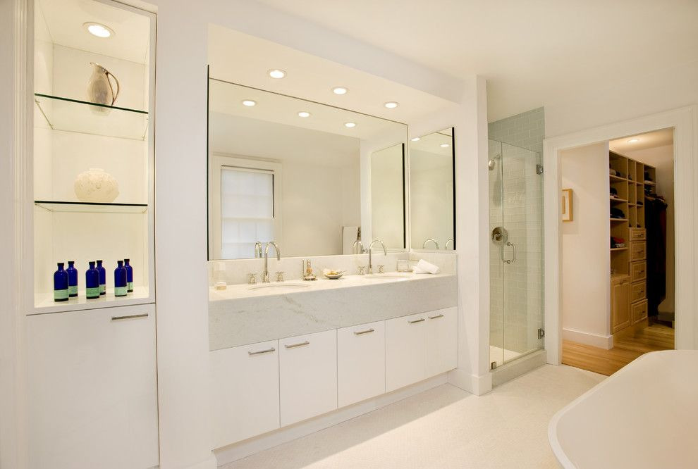 Lowes Torrance for a Modern Bathroom with a White Cabinets and Spa Bath in 1915 Colonial by Charlie Allen Renovations, Inc.