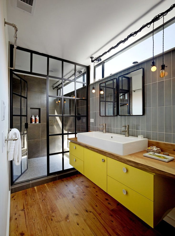 Lowes Yuma Az for a Industrial Bathroom with a Yellow Cabinets and San Francisco Floating House by Robert Nebolon Architects
