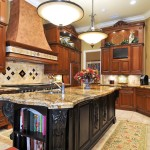 Luna Pearl Granite for a Mediterranean Kitchen with a Kitchen Ledge and Grand Kitchen by Bella Luna Services, Inc.