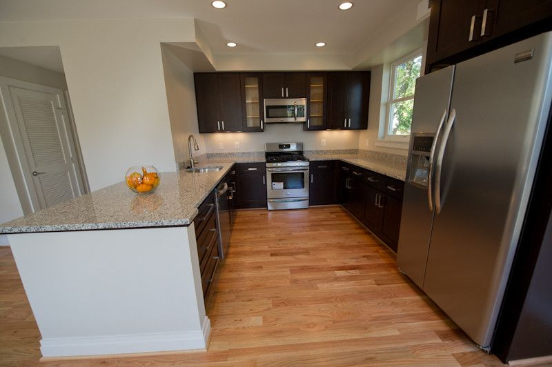 Luna Pearl Granite for a Traditional Kitchen with a Open and Dc Townhouse Renovation by Urban7properties