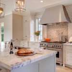 Luna Pearl Granite for a Transitional Kitchen with a White Cabinets Kitchen and Seattle Kitchen Remodel by Beverly Bradshaw Interiors