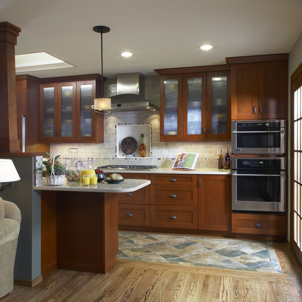 Mannington Commercial for a Traditional Kitchen with a Glass Door Fronts and Kitchen by Harrell Remodeling, Inc.