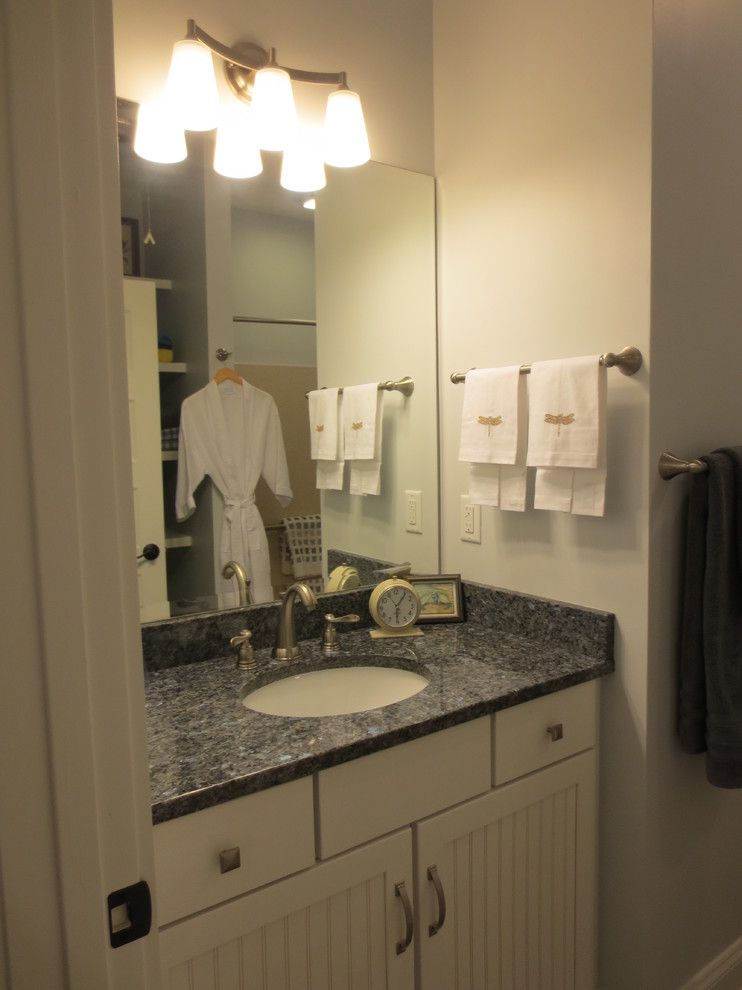 Manteo Furniture for a Beach Style Bathroom with a Asia Evans and the Wright Place by Obx Interiors