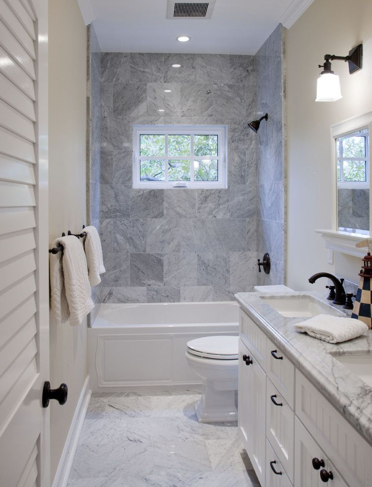 Marble Institute of America for a Beach Style Bathroom with a Marble and America's Cup Bathroom by Flagg Coastal Homes