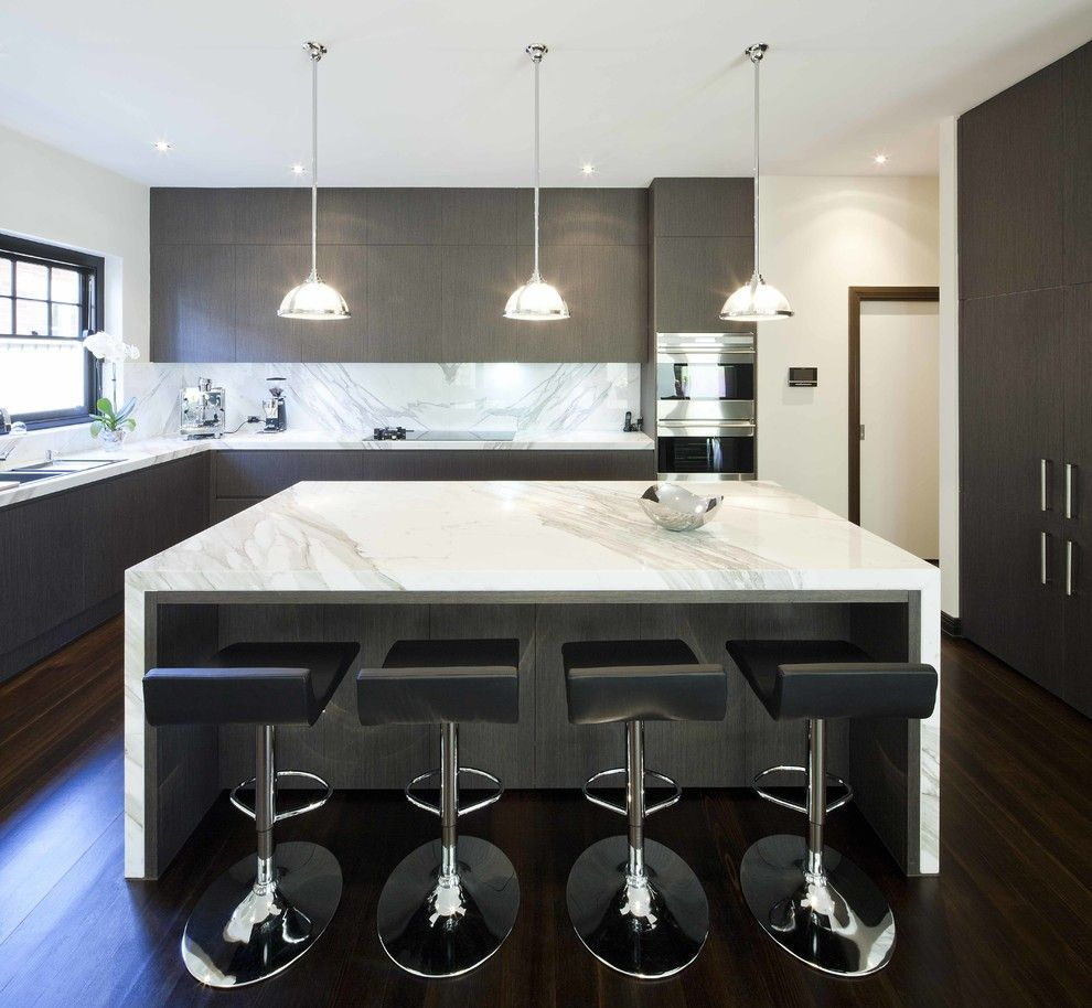 Marble Institute of America for a Contemporary Kitchen with a Dark Wood Floor and Classic Contemporary by Mint Kitchen Group