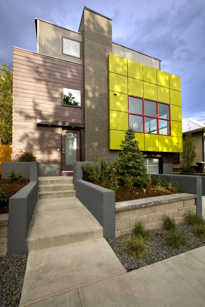 Marlette Homes for a Modern Exterior with a Gray Concrete Wall and Green Cube - LEED Platinum Showhome by RE.DZINE