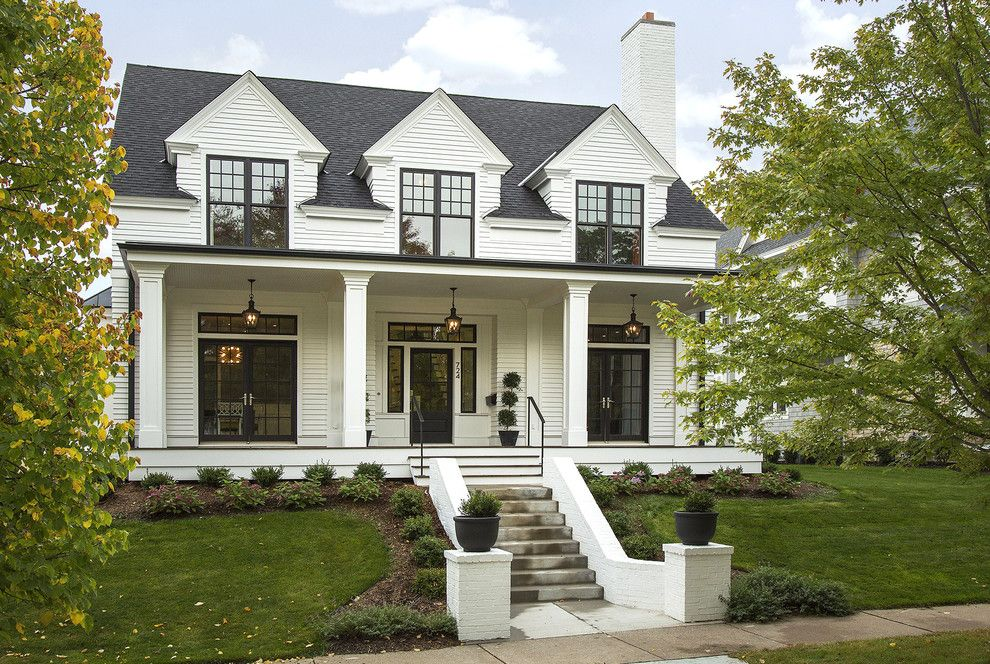 Marvin Integrity for a Transitional Exterior with a Porch and Modern Colonial Four Square by Charlie & Co. Design, Ltd