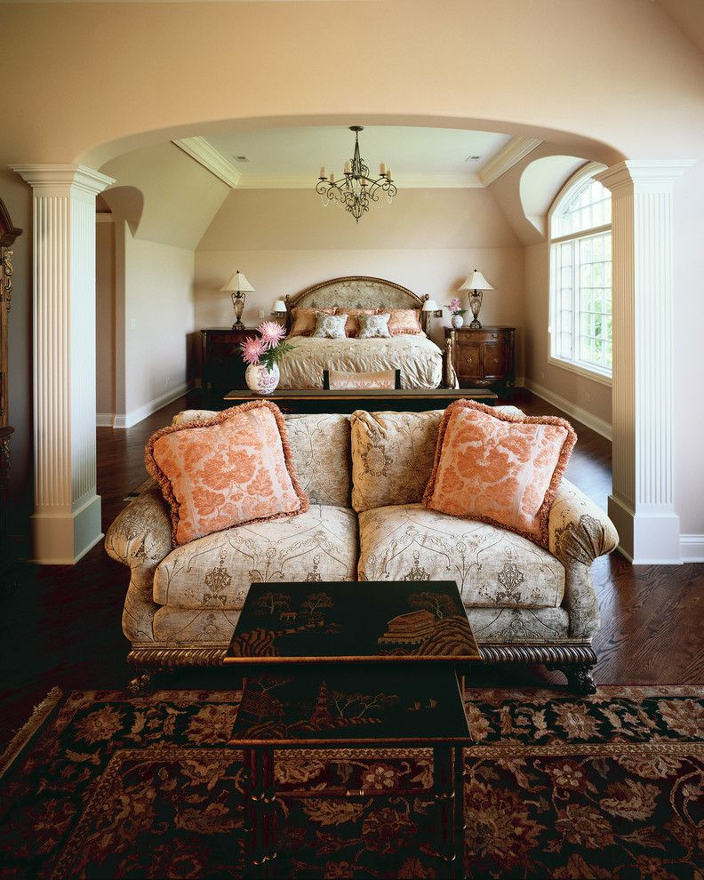 Master Bedroom Decorating Ideas for a Traditional Bedroom with a Chandelier and Country French Brick and Stone House in Long Grove by Orren Pickell Building Group