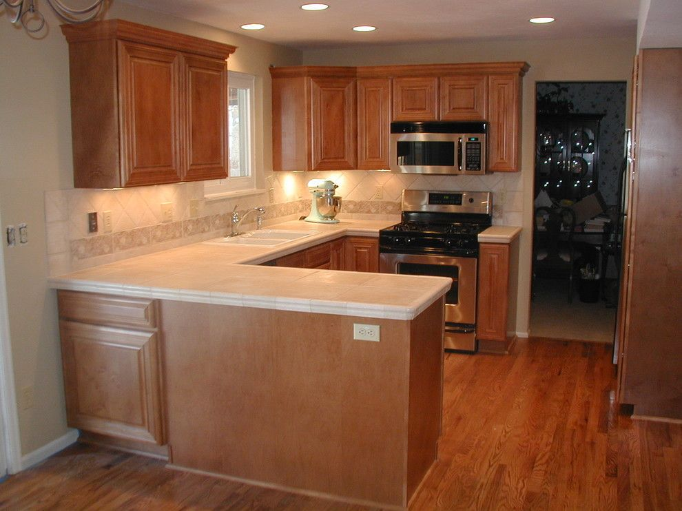 Mastercraft Cabinets for a Traditional Kitchen with a Kitchens and Mastercraft Maple Kitchen by Gerard Construction and Design Services, Llc