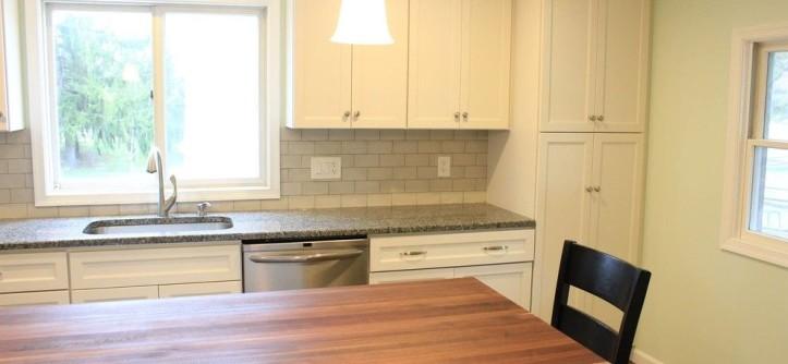 Mastercraft Cabinets for a Transitional Kitchen with a White Kitchen and Joseph Kitchen Conversion by MasterCraft Kitchen & Bath