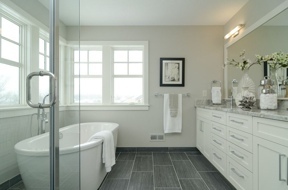 Matthews Building Supply for a Farmhouse Bathroom with a Granite and Vernacular Revival by Boyer Building Corporation