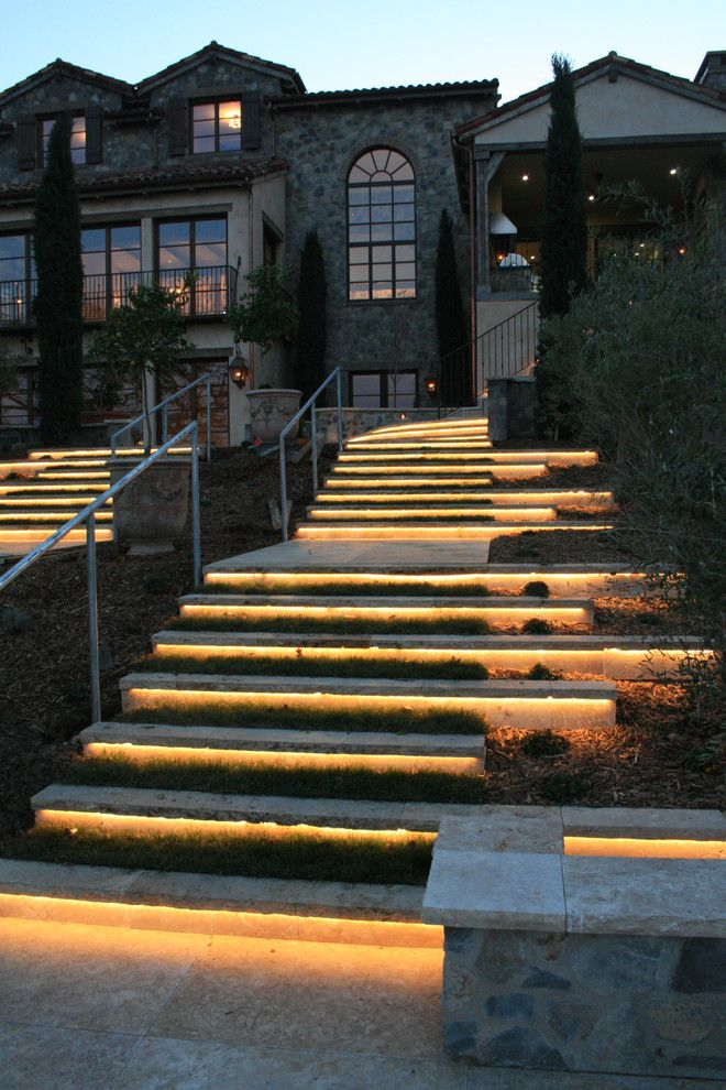 Matthews Building Supply for a Mediterranean Landscape with a Wallstone and Showcase Project   Natural Stone Lit Steps by Sbi Building Materials & Landscape Supplies