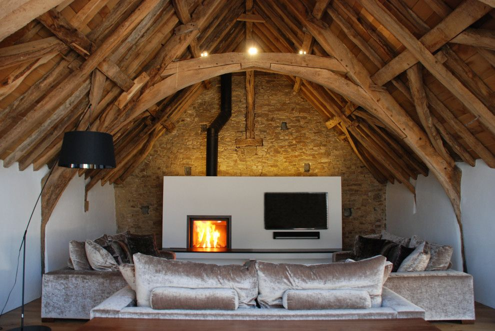 Matthews Building Supply for a Rustic Living Room with a Lime Plaster and Grade Ii* Listed Medieval Barn Conversion, Bude, Cornwall, Uk by the Bazeley Partnership