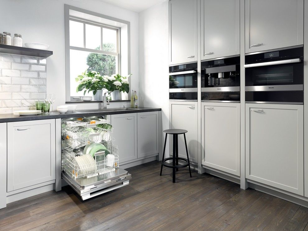 Mcnear Brick for a Modern Kitchen with a Black Countertop and Miele by Miele Appliance Inc