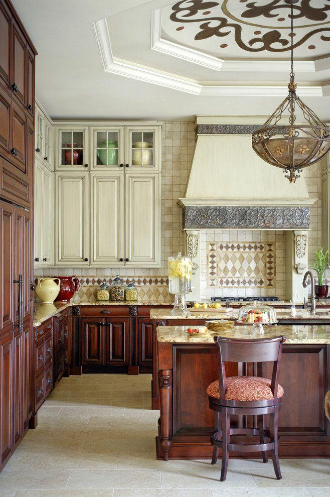 Medallion Cabinets for a Mediterranean Kitchen with a Tile Backsplash and Mediterranean Kitchen by Tobifairley.com