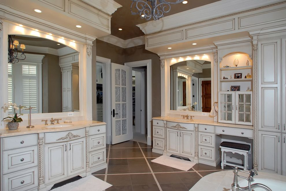 Medallion Cabinets for a Traditional Bathroom with a Bathtub and Bathrooms by Kisarau Architect, Ltd.