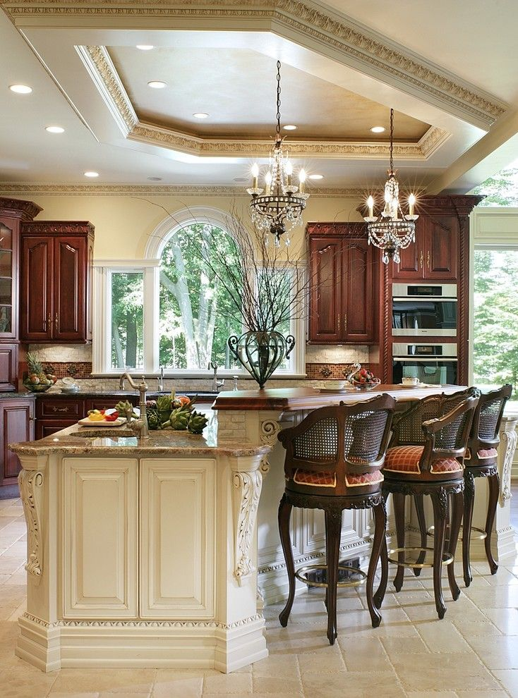 Medallion Cabinets for a Traditional Kitchen with a Tray Ceiling and Whole House Renovation by Creative Design Construction, Inc.