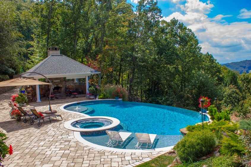 Medallion Pools for a Traditional Pool with a Swim Jets and Sunset Pool by Medallion Pool Co.