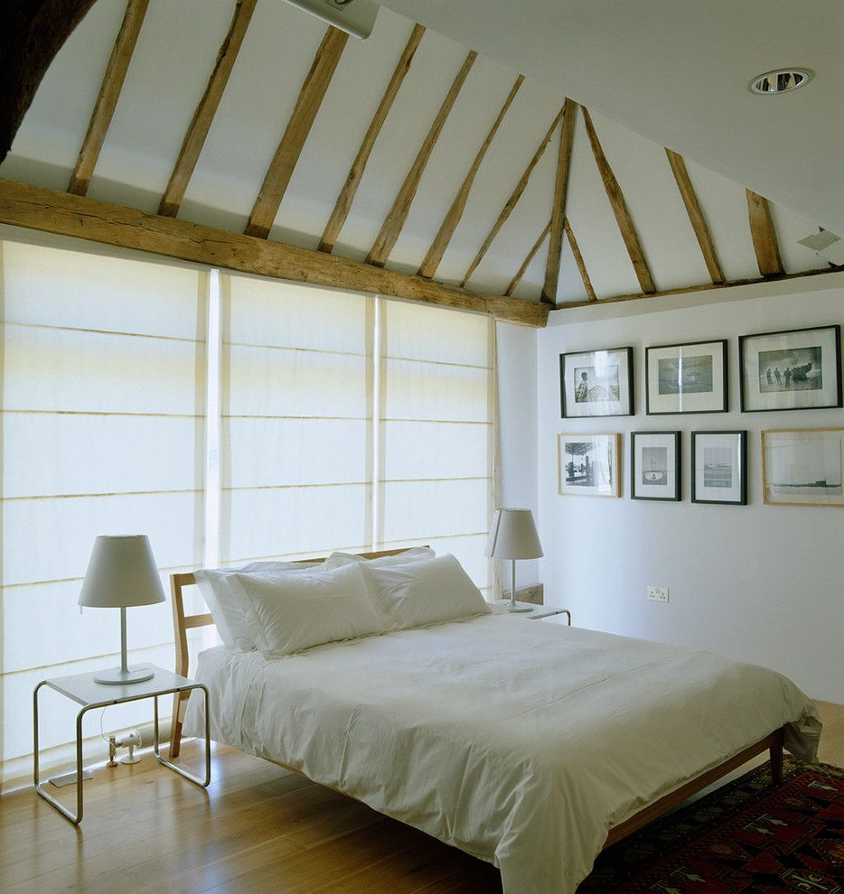 Mens Bedroom Ideas for a Farmhouse Bedroom with a Window Wall and Saling Barn by Pocknell Studio