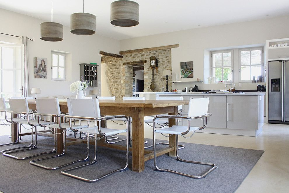 Metal Mart Lehi for a Contemporary Dining Room with a Kitchen Island and the Provence Home of Chantal and Harry by Holly Marder