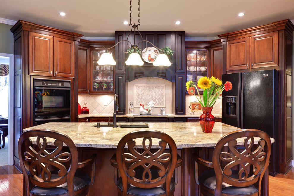 Mid Continent Cabinets for a Traditional Kitchen with a Breakfast Bar and Teri Turan by Turan Designs, Inc.
