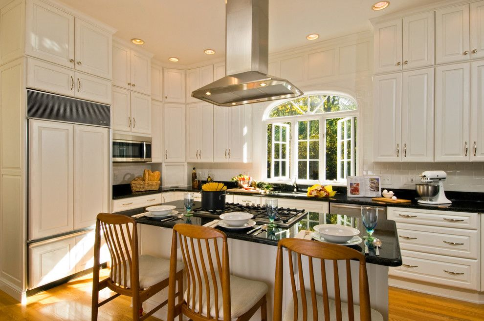 Mid Continent Cabinets for a Traditional Kitchen with a Large Island Island Ventilation Tall Cabinets White Kitchen and Kitchen in a Mansion by Kitchen and Bath World, Inc