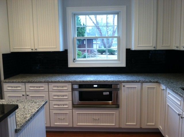 Midcontinent Cabinetry for a Traditional Kitchen with a Midcontinent Cabinetry and Hooper Kitchen by 84 Lumber Co