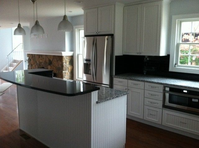 Midcontinent Cabinetry for a Traditional Kitchen with a White Painted Maple Kitchen Cabinetry and Hooper Kitchen by 84 Lumber Co