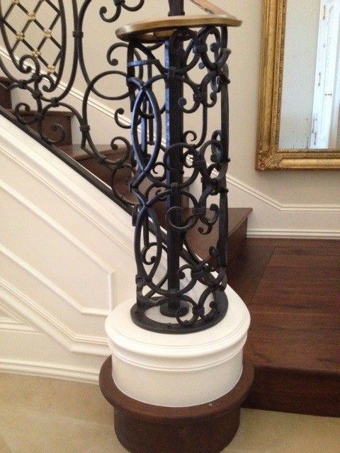 Milliken Millwork for a Mediterranean Staircase with a Curved Newel and Northern Michigan Home by Thomas & Milliken Millwork, Inc.