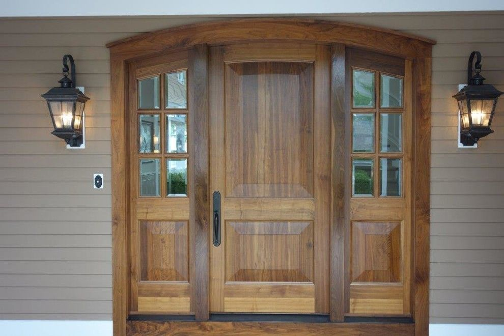 Milliken Millwork for a Rustic Exterior with a Exterior Door and Northern Michigan Home by Thomas & Milliken Millwork, Inc.