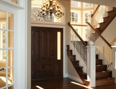Milliken Millwork for a Traditional Entry with a Sair Treads and Staircase with Newels by Thomas & Milliken Millwork, Inc.