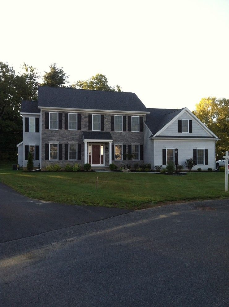 Minwax Stain Colors for a Traditional Exterior with a Vinyl Siding and Brick and the Normandy by Viscusi Builders Ltd.