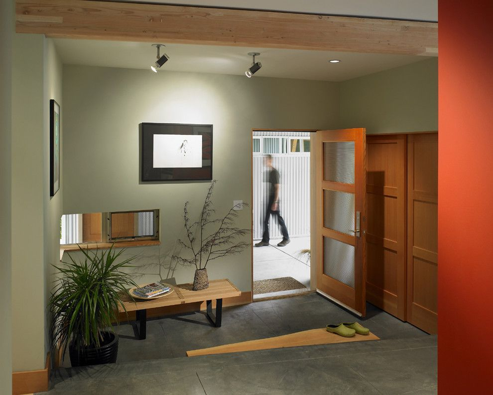 Mirage Flooring for a Contemporary Entry with a Corner Window and Vashon Residence Entry by Goforth Gill Architects