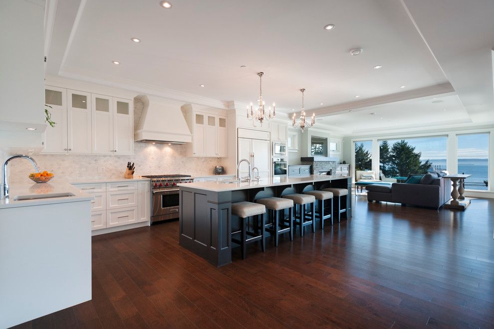 Mirage Hardwood for a Transitional Kitchen with a Huge Island and West Vancouver Horizon by Sarah Gallop Design Inc.