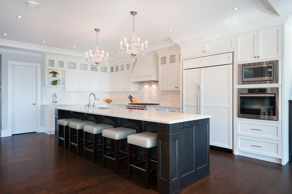 Mirage Hardwood for a Transitional Kitchen with a Wolf Range and West Vancouver Horizon by Sarah Gallop Design Inc.
