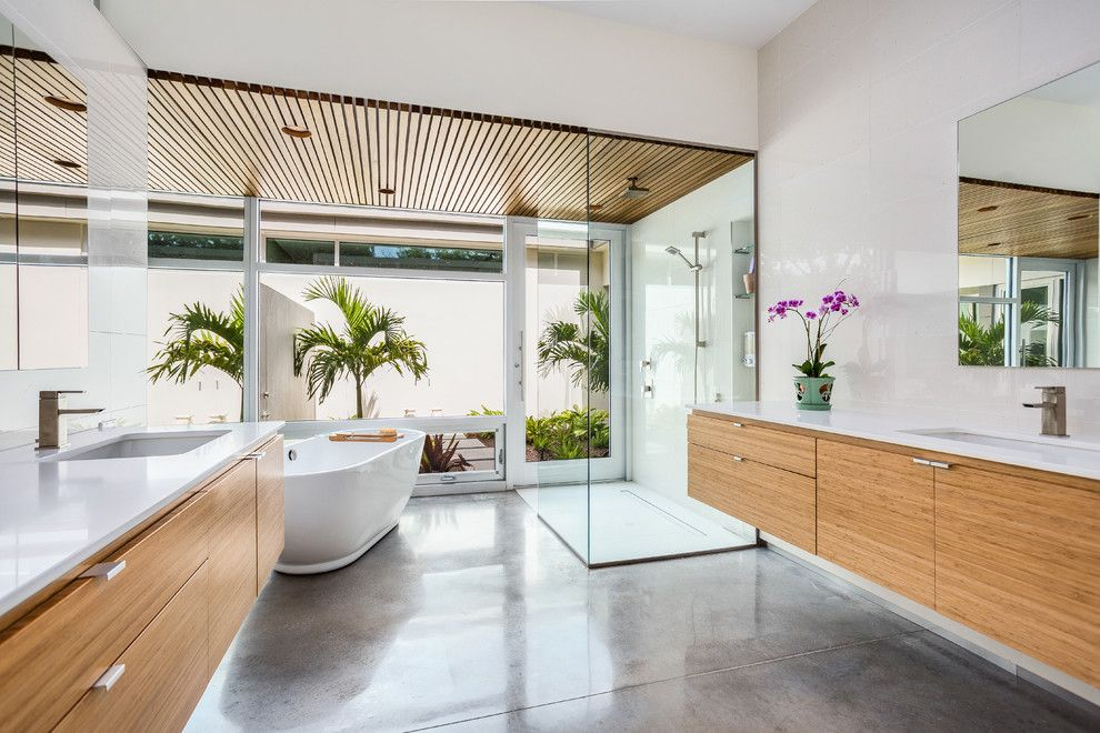 Missing Piece Tampa for a Contemporary Bathroom with a Wood Panel Ceiling and Lotus on Orange by Josh Wynne Construction